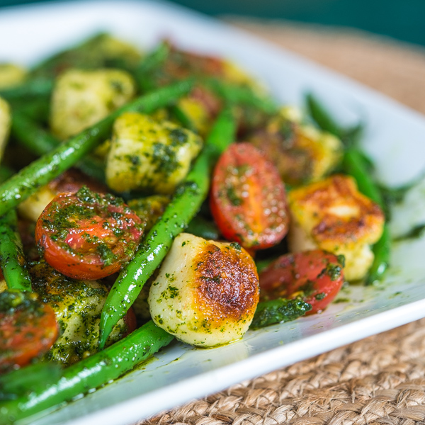 pesto gnocchi with haricots verts and grape tomatoes