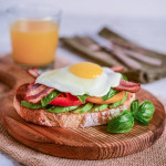 Avocado Toast with Heirloom Tomatoes, Basil, Bacon, and Egg
