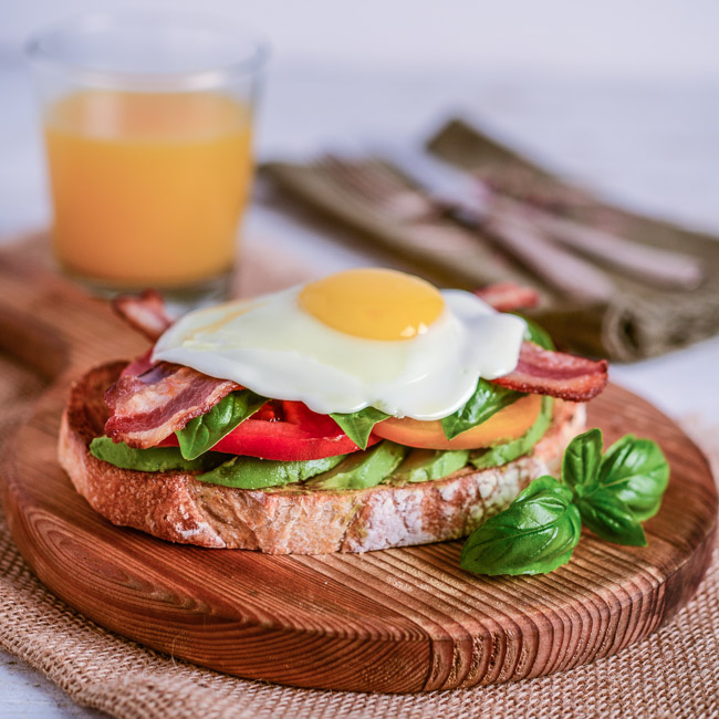Avocado Toast with Heirloom Tomatoes, Basil, Egg, and Bacon